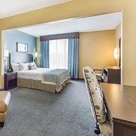A spacious King hotel room with a vanity at the Wingate by Wyndham Resort