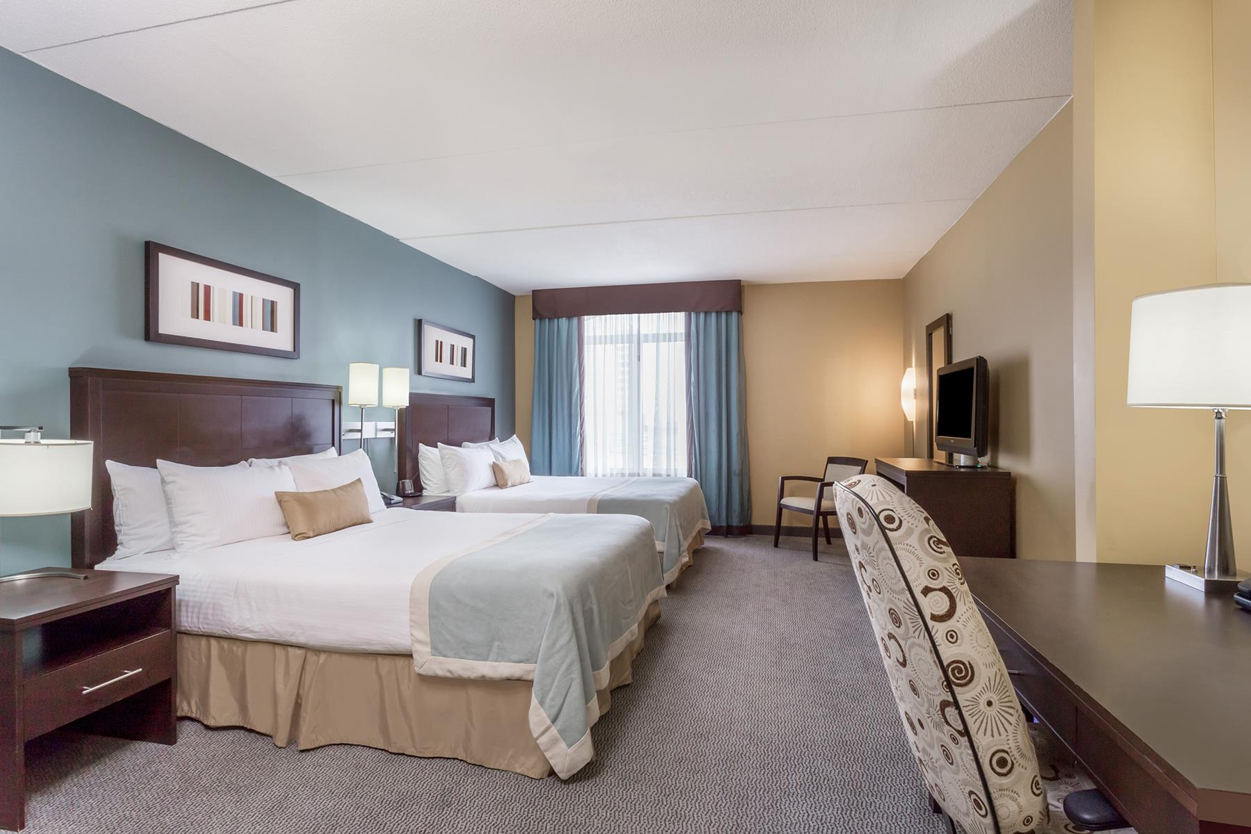 A spacious double queen bedroom suite in the Wingate by Wyndham hotel in Regina Saskatchewan