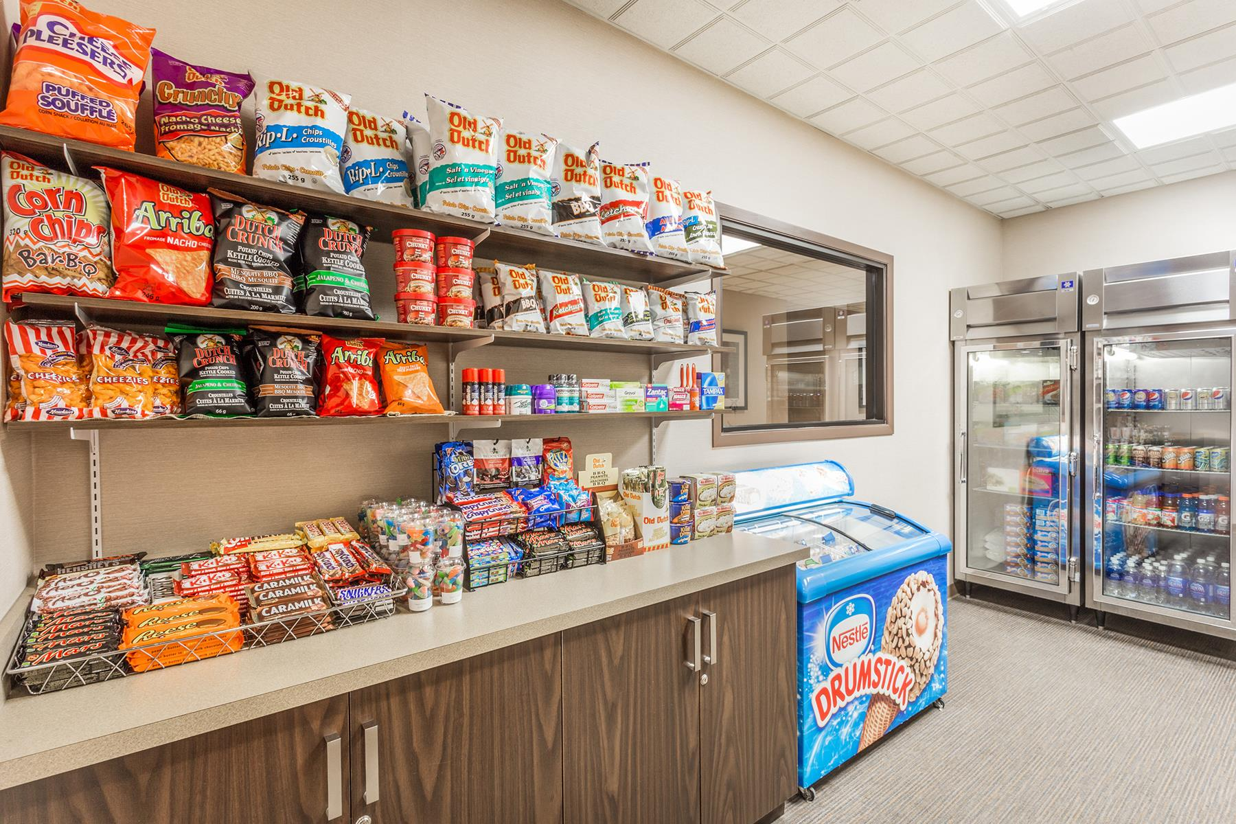 A convenience shop in the Wyndham Regina SK resort including soda, chips, candy bars, ice cream and more