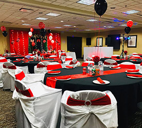 Wheatland Room decorated in black and red at the Wingate by Wyndham Regina