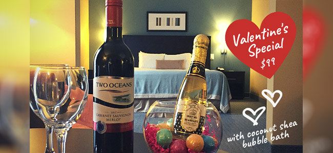 Hotel guestroom with wine bottle and wine glasses